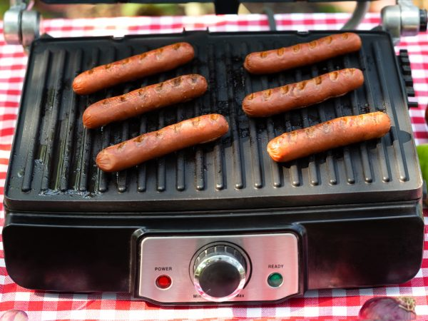 Grilled sausages on an electric grill